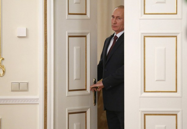 Russia's President Vladimir Putin enters a hall for a meeting with Royal Dutch Shell CEO Ben van Beurden  in the Novo-Ogaryovo residence outside Moscow, on April 18, 2014. The chief executive of Anglo-Dutch energy giant Royal Dutch Shell Ben van Beurden met today President Vladimir Putin at his private residence, telling the Russian strongman that the company wanted to expand its operations in Russia. The European Parliament called on yesterday for the EU to reinforce sanctions on Russia over the Ukraine crisis and be prepared to target economic interests. AFP PHOTO/  POOL / MAXIM SHIPENKOV