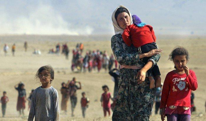 Auf der Flucht: Jesiden nahe der syrischen Grenze, verfolgt vom Islamischen Staat, im August 2014 Foto: Rodi Said / Reuters